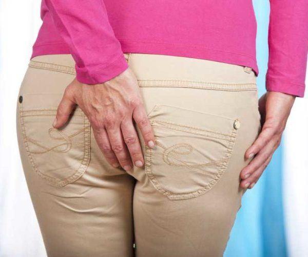 Почему во время месячных болит задний проход